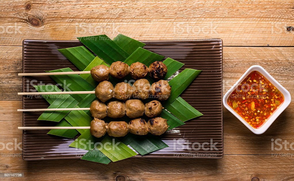 Grilled beef meatballs in a plate on wooden background stock photo