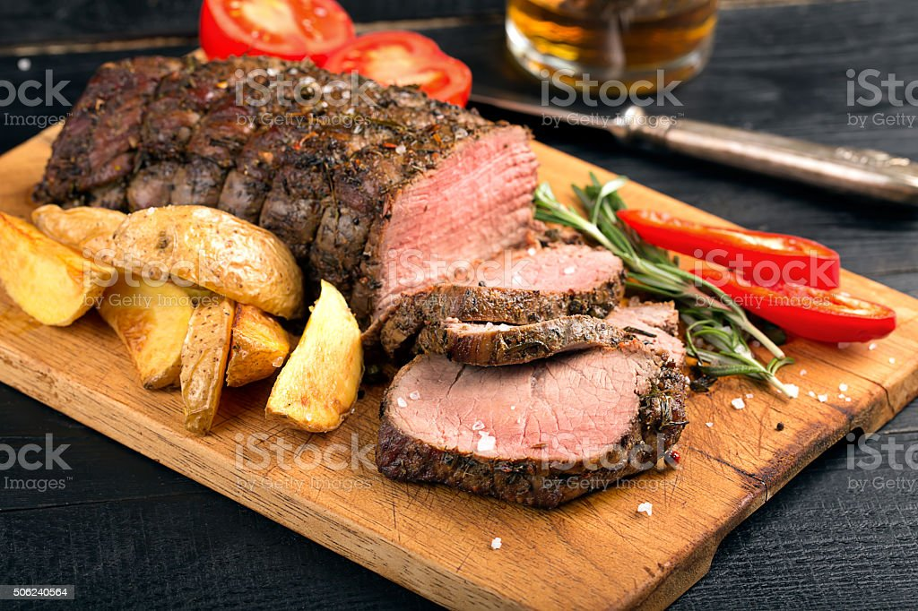 Grilled beef on a cutting board stock photo