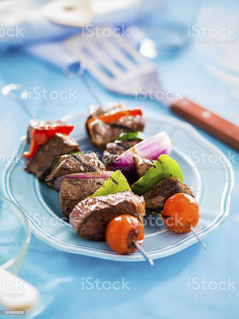 grilled beef shishkabobs on table royalty-free stock photo