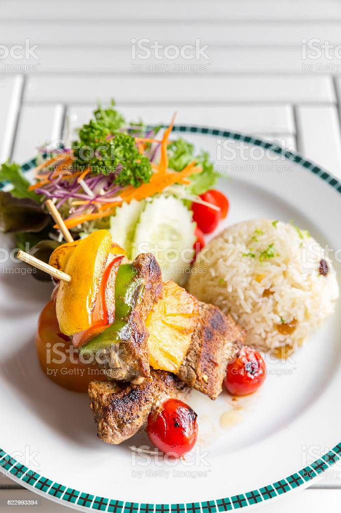grilled beef skewer with rice stock photo