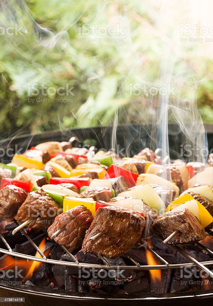 Grilled beef skewers with onions and peppers color. stock photo