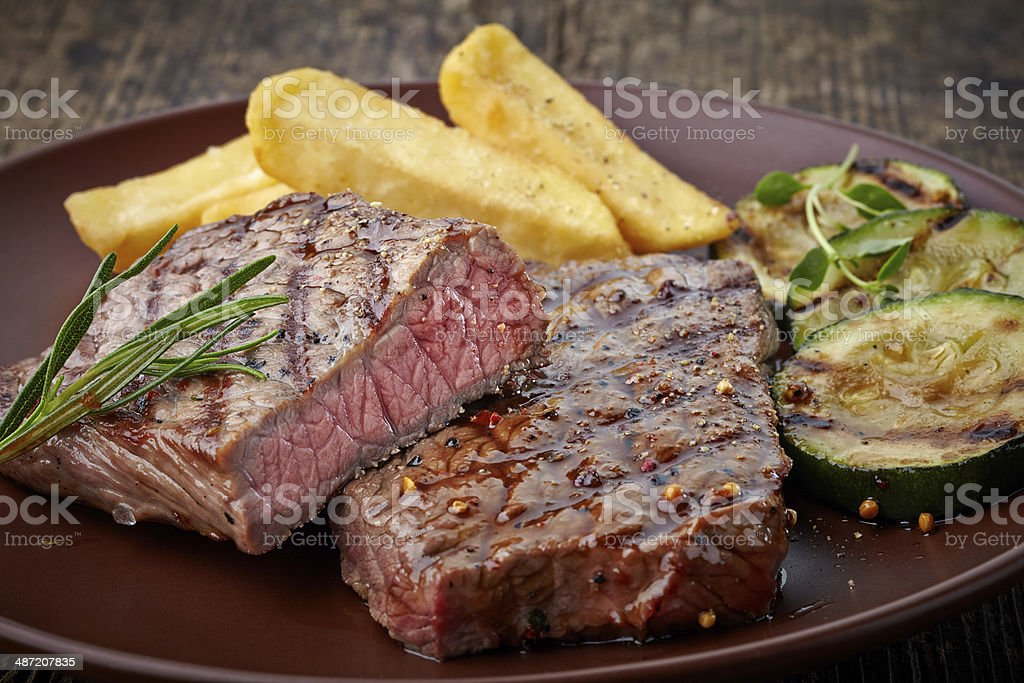 grilled beef steak on wooden cutting board stock photo