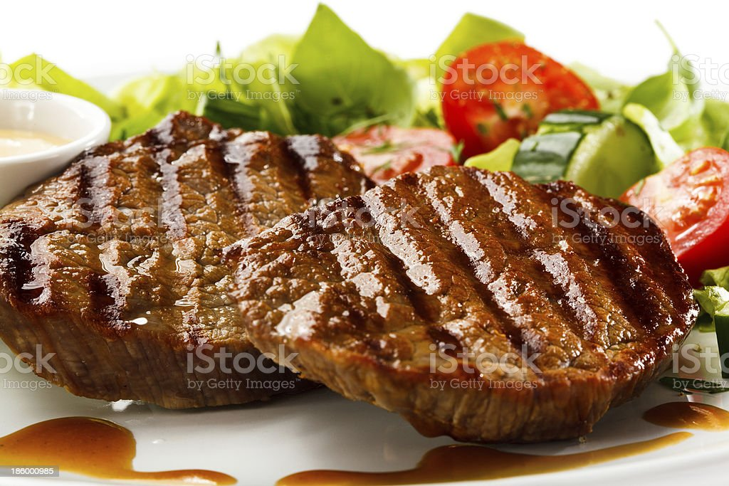 Grilled beefsteak and vegetables royalty-free stock photo