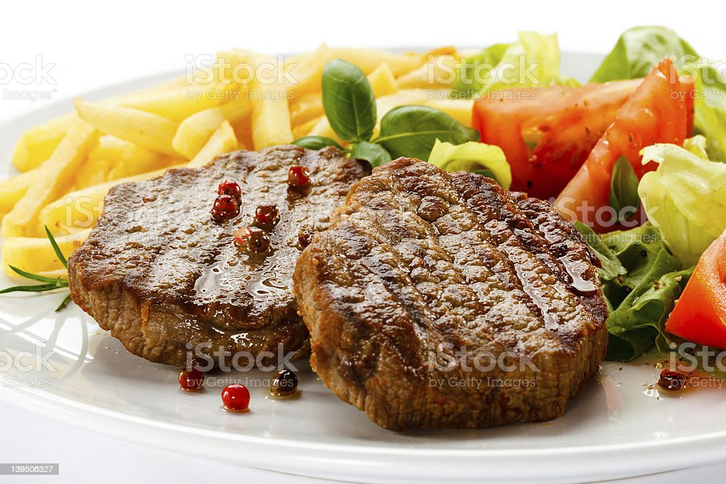 Grilled beefsteak French fries and vegetables royalty-free stock photo