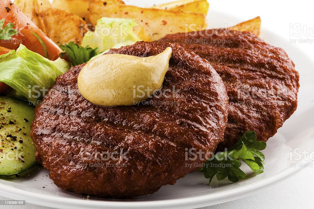 Grilled beefsteaks and vegetables royalty-free stock photo
