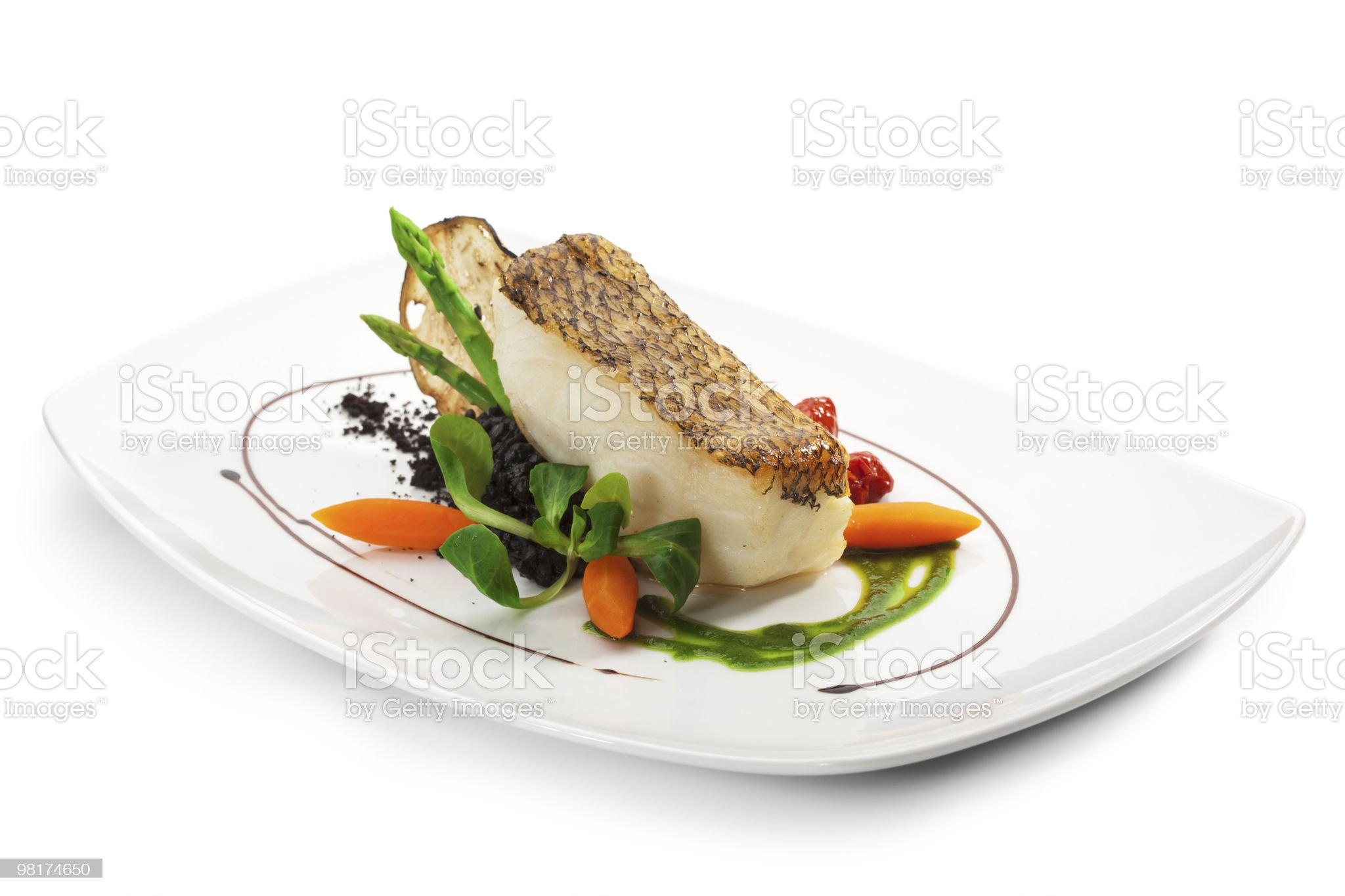 Grilled black sea bass served with vegetables royalty-free stock photo