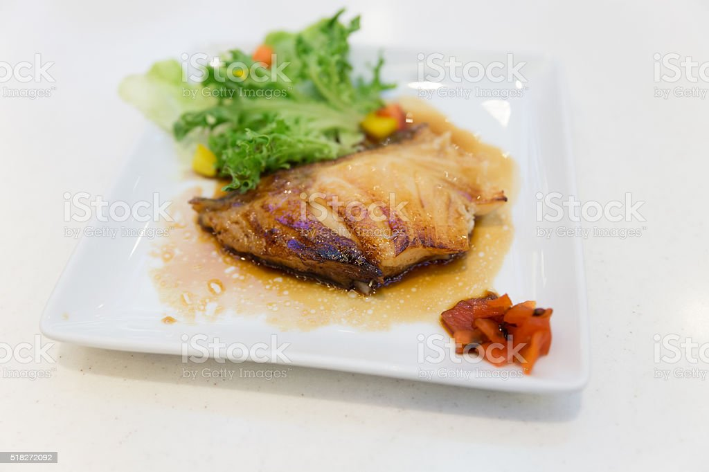 grilled bluefish serving with vegetable stock photo