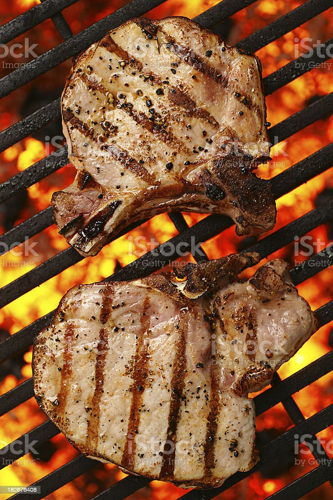 Grilled Bone-In Pork Chops stock photo