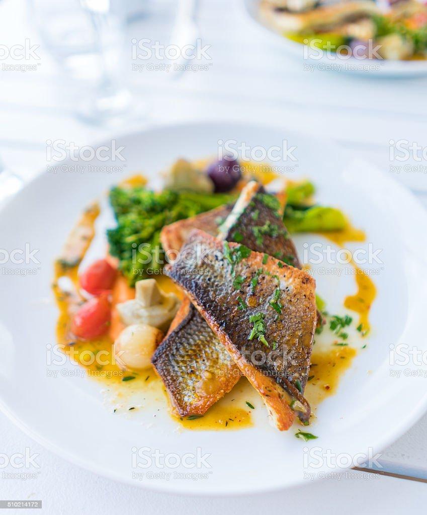 Grilled branzino fish steaks stock photo