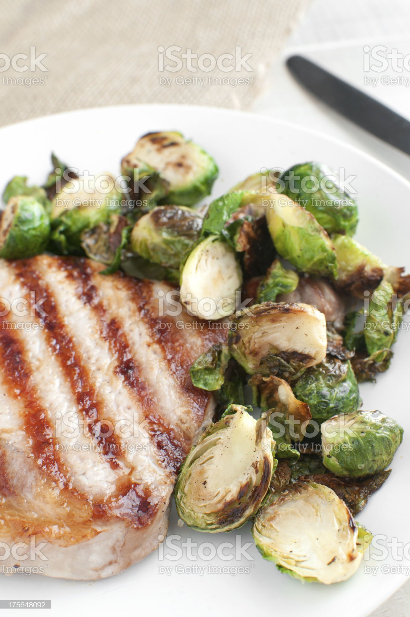 Grilled brussels sprouts and pork meat royalty-free stock photo