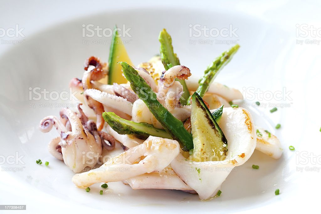 Grilled calamari with green asparagus. royalty-free stock photo