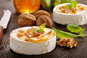 Grilled camembert cheese with honey and nuts