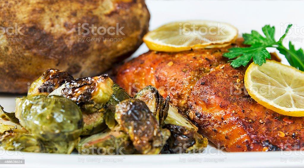 Grilled cedar plank salmon filet dinner stock photo
