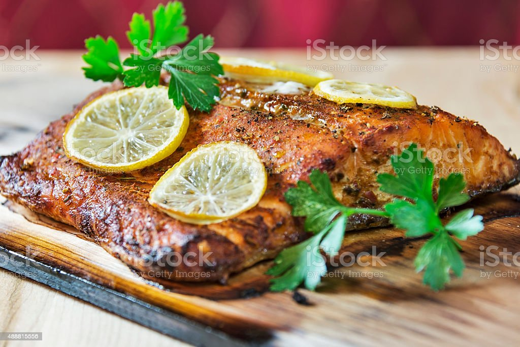Grilled cedar plank salmon filet stock photo