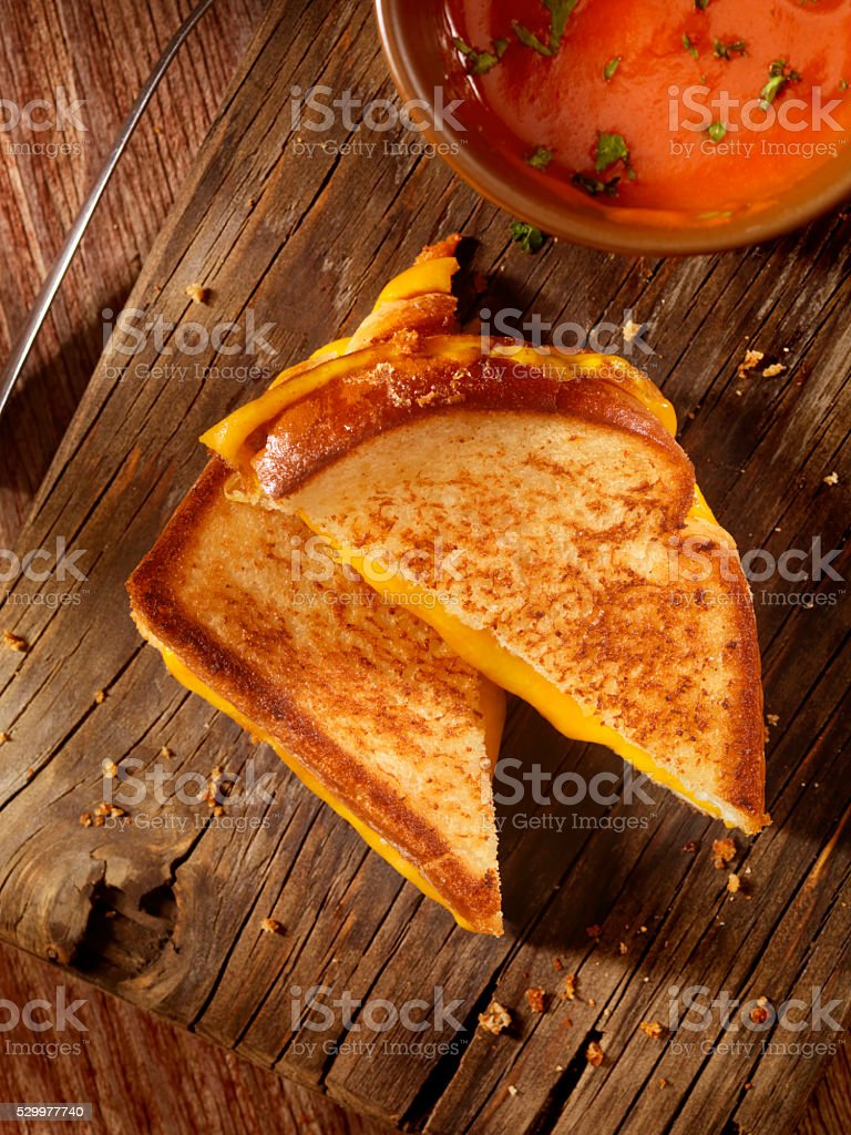 Grilled Cheddar Cheese Sandwich with Tomato Soup stock photo