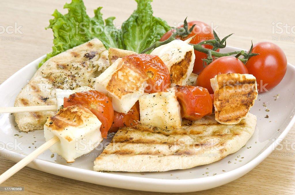 grilled cheese(haloumi) and tomato souvlaki royalty-free stock photo