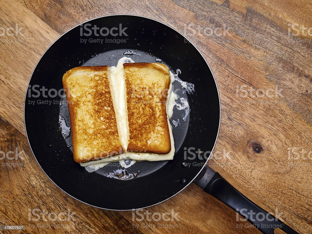Grilled cheese sandwich on skillet stock photo