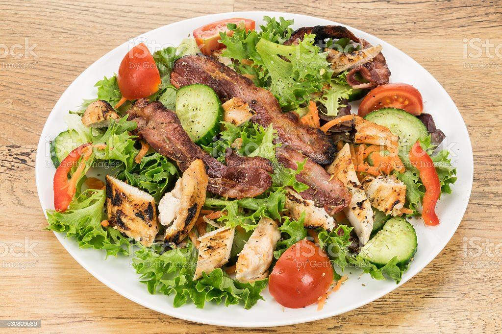 Grilled chicken and bacon salad stock photo