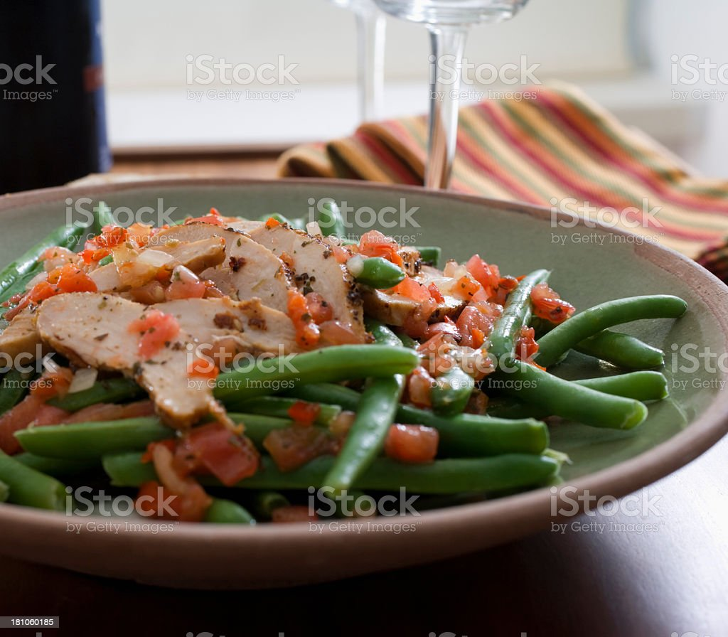 Grilled chicken and green beans stock photo
