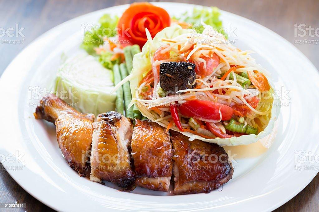 Grilled chicken and papaya salad, Thai food stock photo