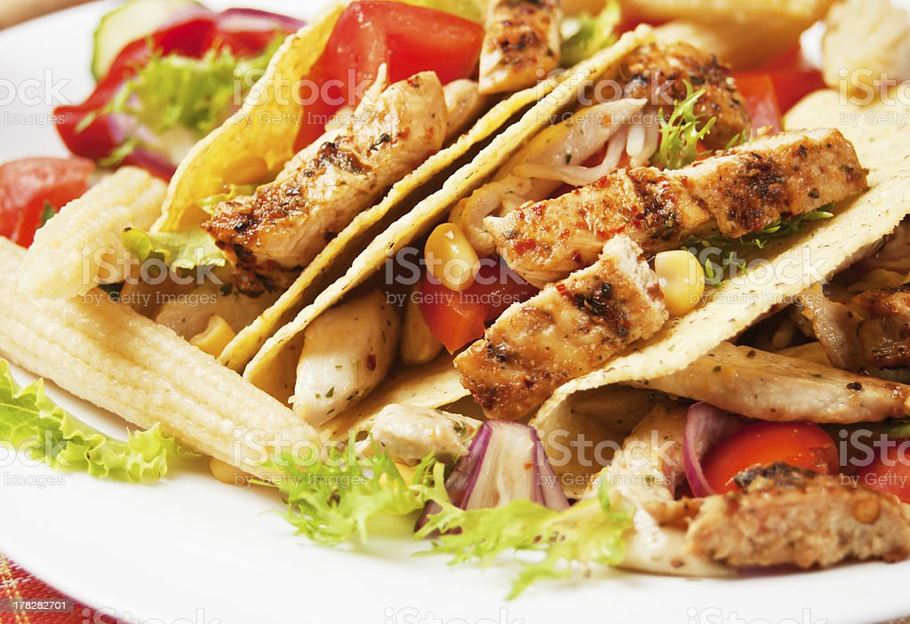 Grilled chicken and salad in taco shells stock photo