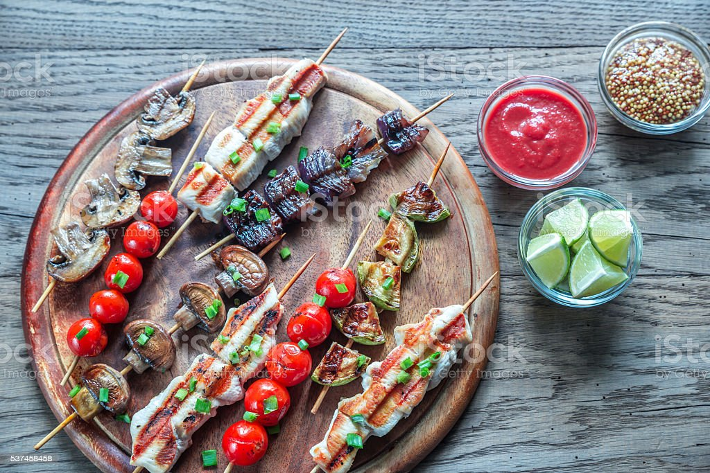 Grilled chicken and vegetable skewers stock photo