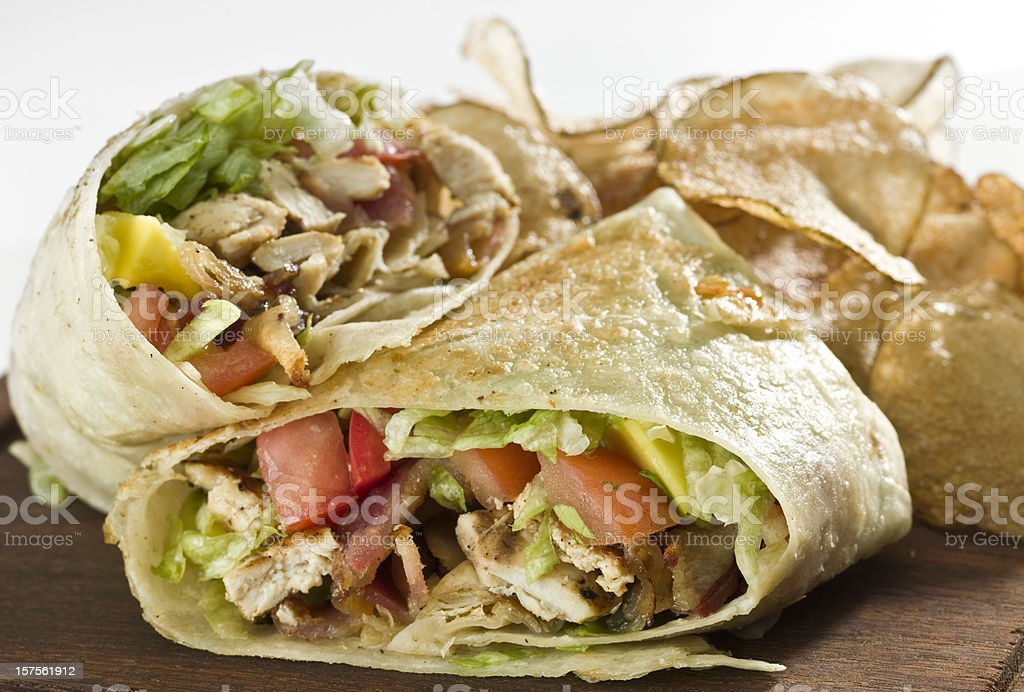 Grilled chicken and vegetables wrap sandwich stock photo
