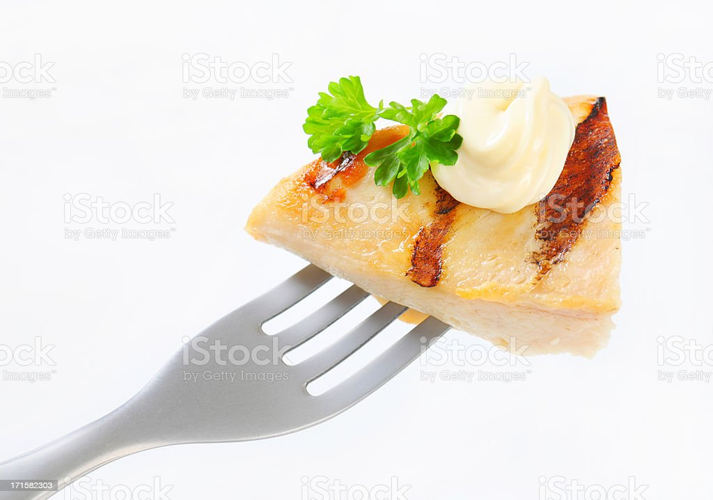 grilled chicken breast on a fork royalty-free stock photo
