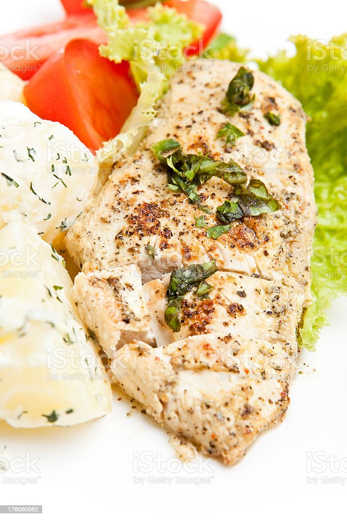 Grilled chicken breast on a plate with fresh vegetables royalty-free stock photo