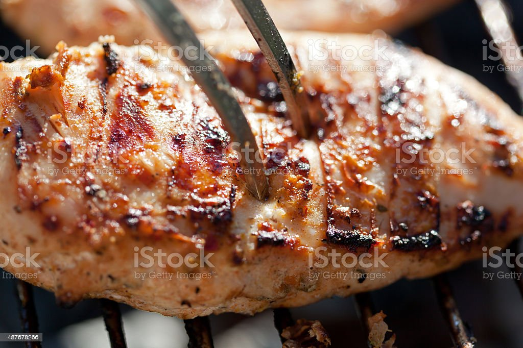 Grilled chicken breast on barbeque stock photo