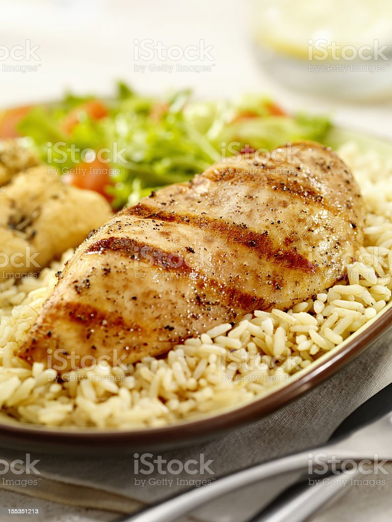 Grilled Chicken Breast with Brown Rice stock photo