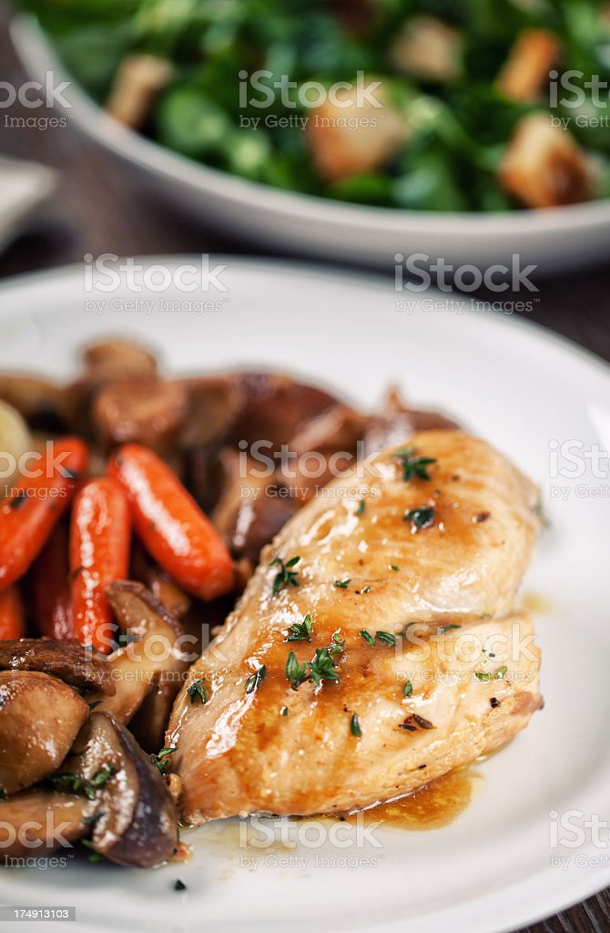 Grilled chicken breast with mushrooms and carrots royalty-free stock photo