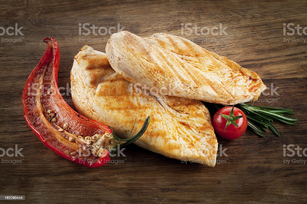 Grilled chicken breast with pepper and tomato stock photo