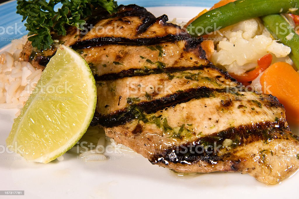 grilled chicken breast with rice and veggies stock photo
