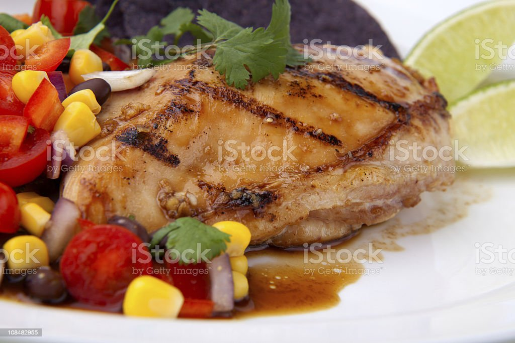 Grilled chicken breast with tomato and corn garnish royalty-free stock photo