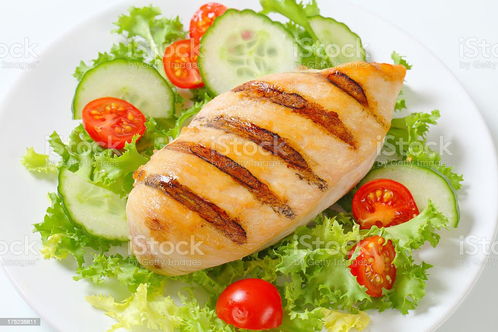 grilled chicken breast with vegetable garnish royalty-free stock photo