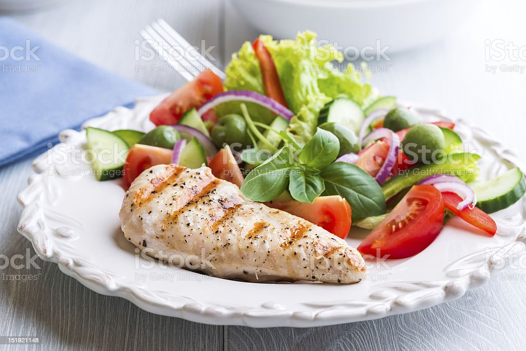 Grilled Chicken Breast with Vegetable Salad stock photo