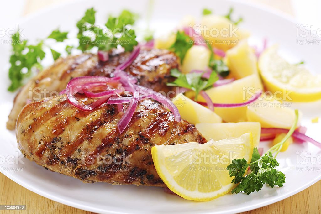 Grilled chicken breast with warm corn and potato salad royalty-free stock photo