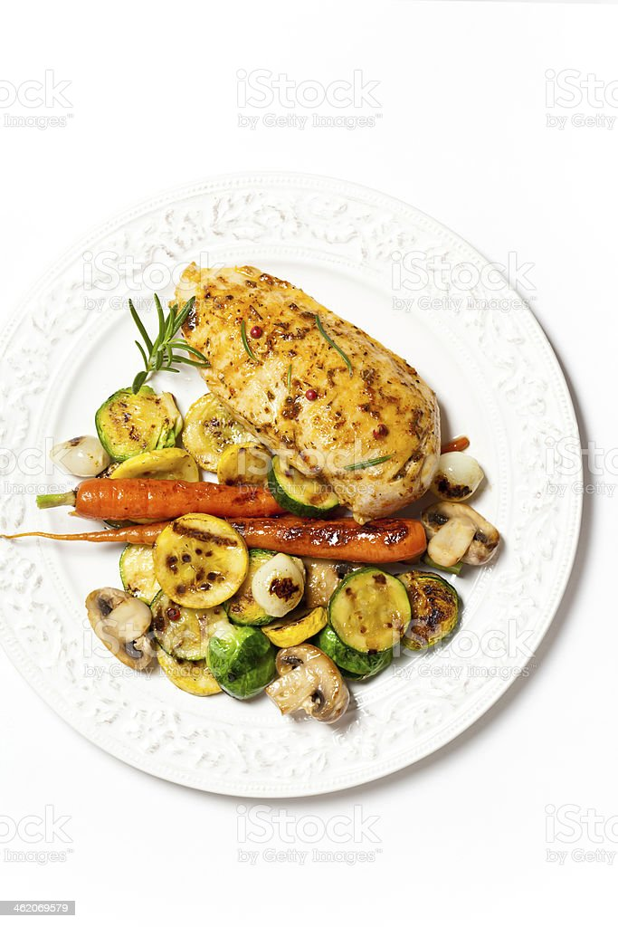 Grilled chicken breasts and vegetables royalty-free stock photo