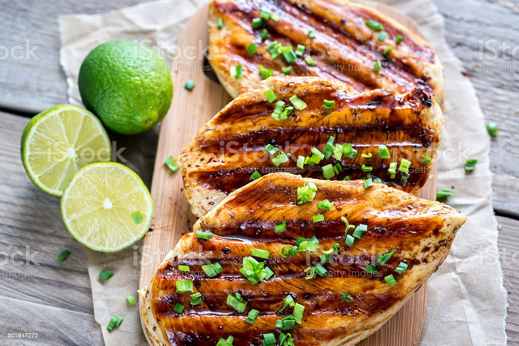 Grilled chicken breasts in lime sauce stock photo