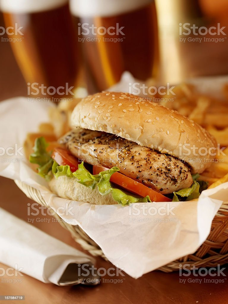 Grilled Chicken Burger with French Fries royalty-free stock photo