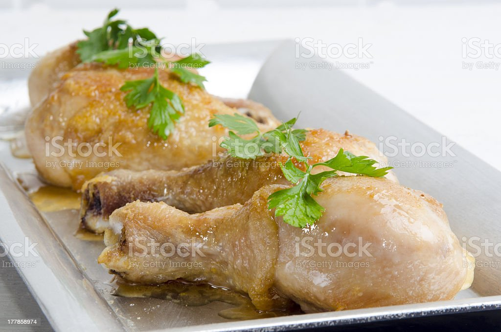 grilled chicken drumstick on a large plate royalty-free stock photo