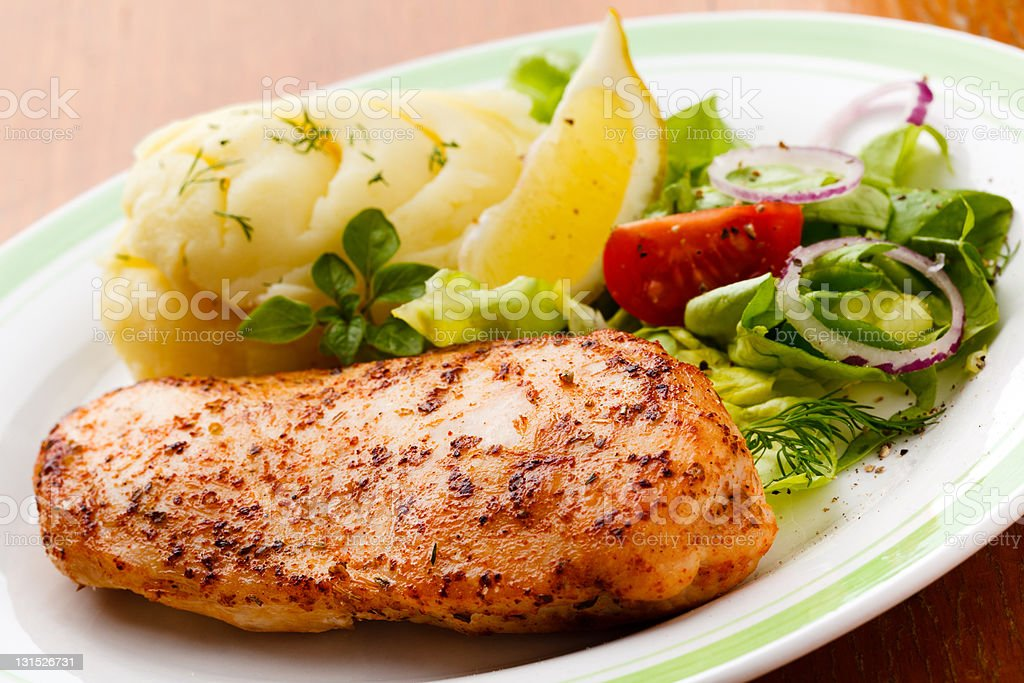 Grilled chicken fillet and mashed potatoes royalty-free stock photo