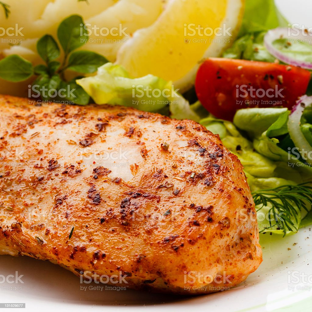 Grilled chicken fillet and vegetables royalty-free stock photo