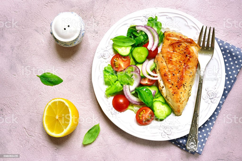 Grilled chicken fillet with vegetable salad. stock photo