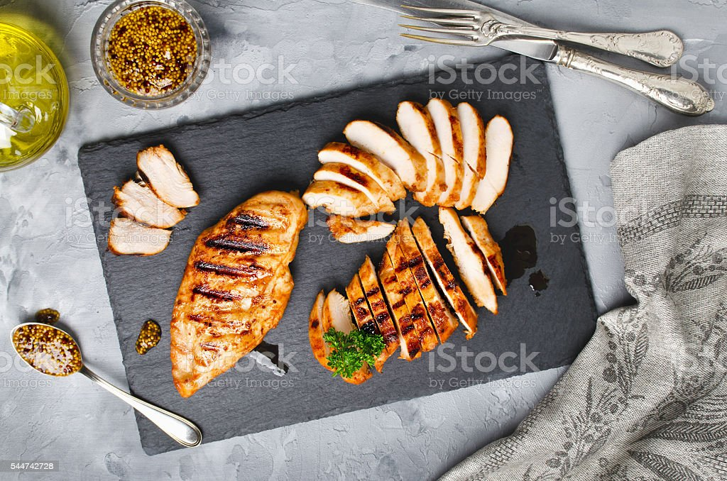 Grilled chicken fillets in a spicy marinade stock photo