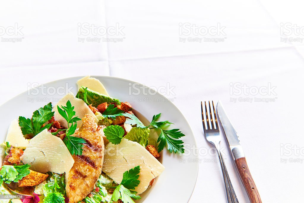 Grilled Chicken garnished with green herbs stock photo