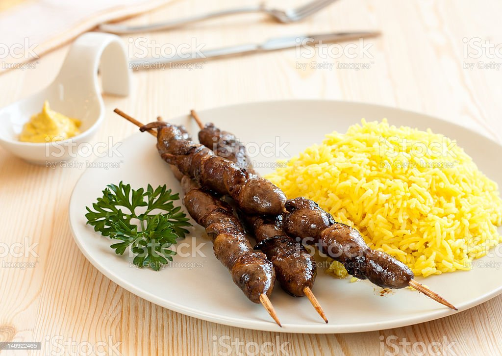 Grilled chicken hearts with turmeric rice royalty-free stock photo