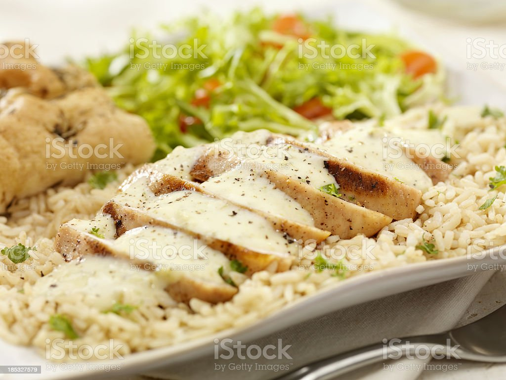 Grilled Chicken in a Cheese and Broccoli cream Sauce stock photo