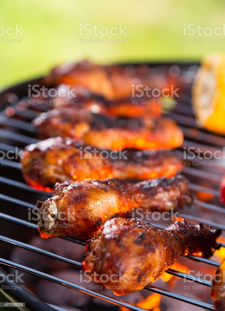 Grilled chicken leg on fire stock photo